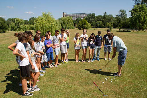 KKCL Juniors summer school students playing golf at Northwick Park PGA golf course, Harrow, UK.