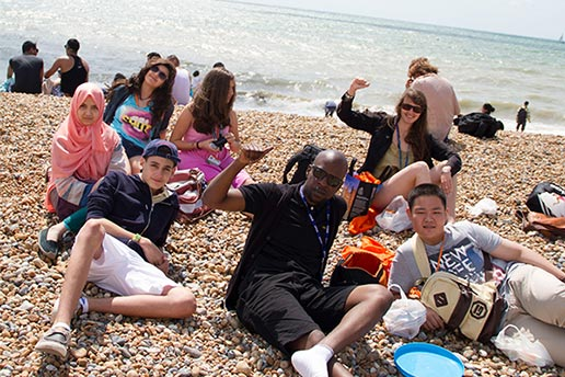 KKCL Juniors summer school students on the beach in Brighton, UK.